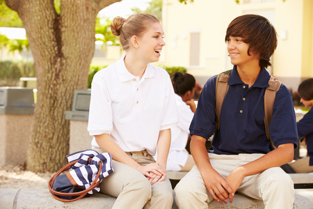 High School Students Wearing Uniforms On School Campus