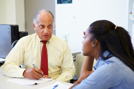 career counseling: Female Student Talking To High School Counselor