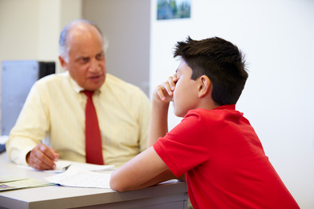 the elderly tutor: Male Student Talking To High School Counselor
