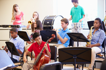 orchestra: Pupils Playing Musical Instruments In School Orchestra