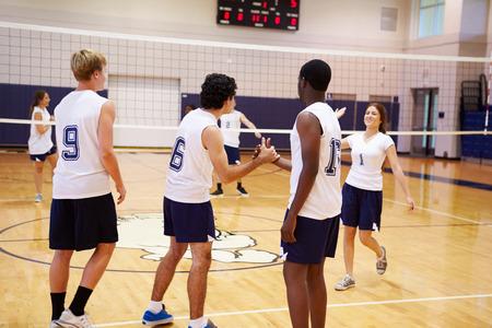 female volleyball: High School Volleyball Match In Gymnasium Stock Photo