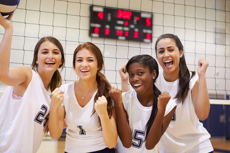 sports uniform: Members Of Female High School Volleyball Team