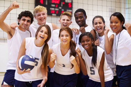 Portrait Of High School Volleyball Team Members With Coach Stock Photo - 33479617