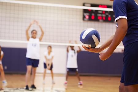 High School Volleyball Match In Gymnasium Foto de archivo