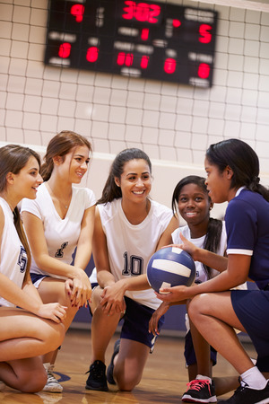 Female High School Volleyball Team Have Team Talk From Coach photo