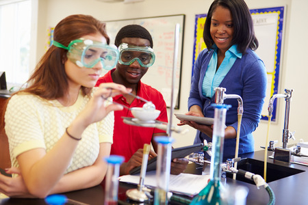 teaching: Pupils Carrying Out Experiment In Science Class Stock Photo