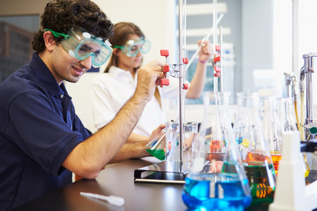 science class: Pupils Carrying Out Experiment In Science Class Stock Photo
