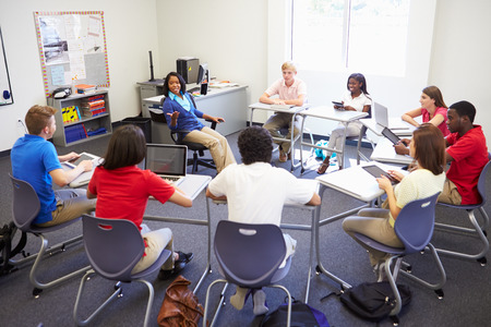 High School Students Taking Part In Group Discussion Stock Photo