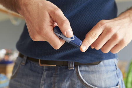blood sugar: Male Diabetic Checking Blood Sugar Levels