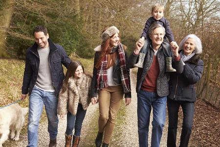 autumn family: Multi Generation Family On Countryside Walk Stock Photo