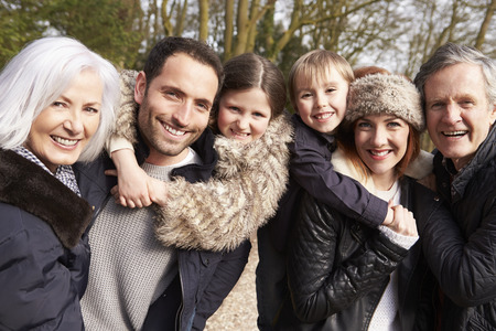 people: Portrait Of Multi Generation Family On Countryside Walk Stock Photo