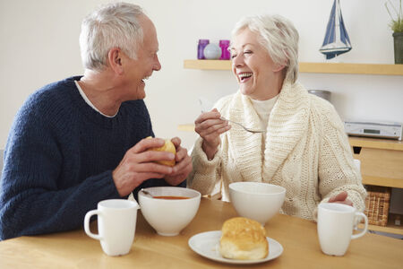 senior eating: Senior Couple Having Bowl Of Soup For Lunch