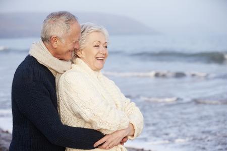Romantic Senior Couple On Winter Beach photo