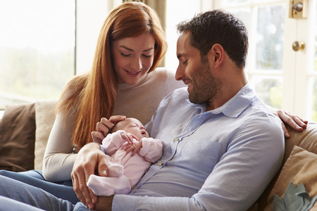 Mother And Father At Home With Newborn Baby Archivio Fotografico