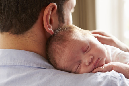 fathers: Father At Home With Sleeping Newborn Baby Daughter