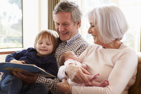 Grandparents With Grandson And Newborn Baby Granddaughter photo