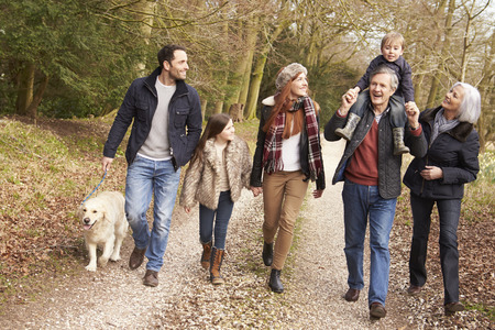 animals and pets: Multi Generation Family On Countryside Walk Stock Photo