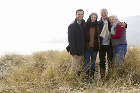 offspring: Parents With Adult Offspring Standing In Dunes