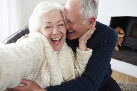 Senior Couple Sitting On Sofa And Relaxing
