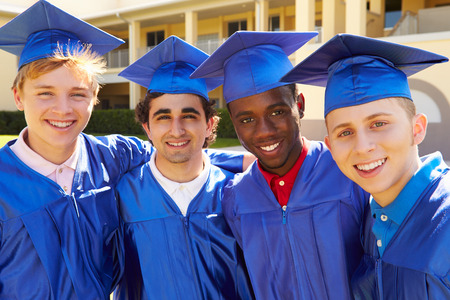 Group Of Male High School Students Celebrating Graduation Stock Photo