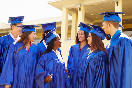 high school graduation: Group Of High School Students Celebrating Graduation