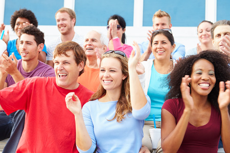 spectator: Spectators Cheering At Outdoor Sports Event Stock Photo
