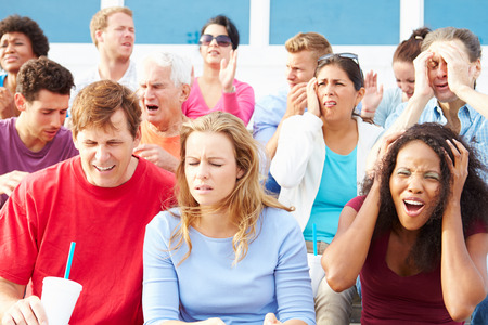 disappointed: Disappointed Spectators At Outdoor Sports Event Stock Photo