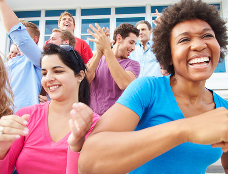 male age 40's: Audience Dancing At Outdoor Concert Performance Stock Photo
