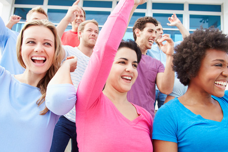 sports venue: Audience Dancing At Outdoor Concert Performance Stock Photo