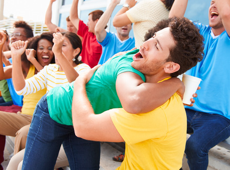 Sports Spectators In Team Colors Celebrating Stock Photo