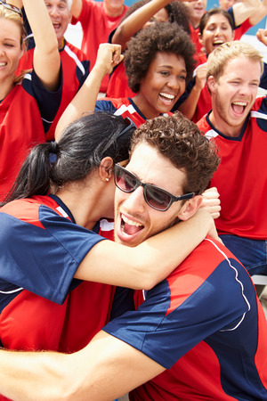 football world cup: Sports Spectators In Team Colors Celebrating Stock Photo