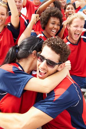 Sports Spectators In Team Colors Celebrating Stock Photo