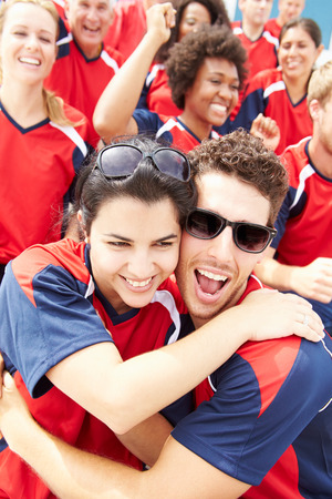 cheering fans: Sports Spectators In Team Colors Celebrating Stock Photo
