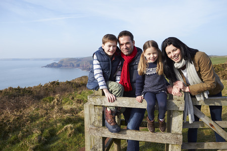 thirties portrait: Portrait Of Family Walking Along Coastal Path