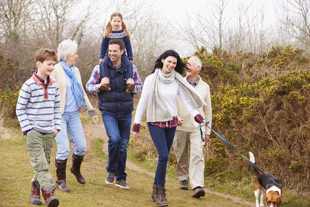 multi generation: Multi Generation Family With Dog On Countryside Walk