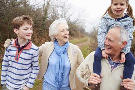 grandchildren: Grandparents With Grandchildren On Walk In Countryside
