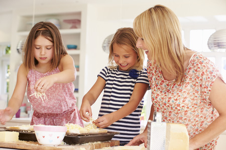 Girls With Mother Making Cheese On Toast photo