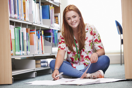 Female College Student Studying In Library Banco de Imagens