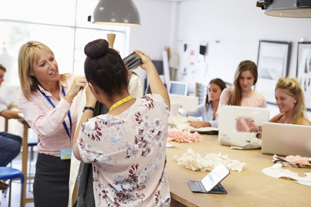 Teacher Helping College Students Studying Fashion And Design Stock Photo - 85401089