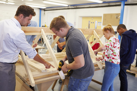 Teacher Helping College Students Studying Carpentry Reklamní fotografie