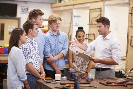 Teacher Helping College Students Studying Plumbing Stock Photo