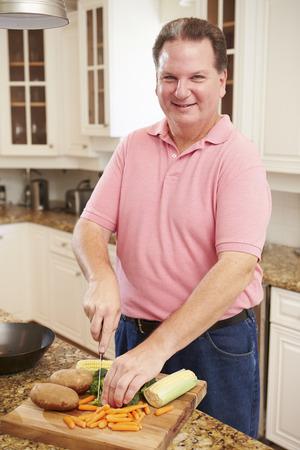 Overweight Man Preparing Vegetables in Kitchen