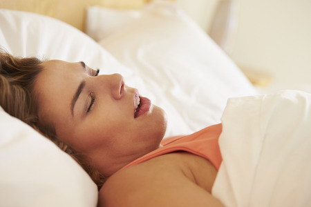 Overweight Woman Asleep In Bed Snoring photo