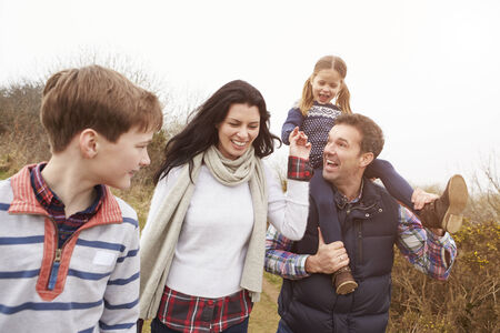 Family On Countryside Walk Stock Photo