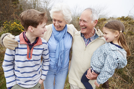 Grandparents With Grandchildren On Walk In Countryside photo