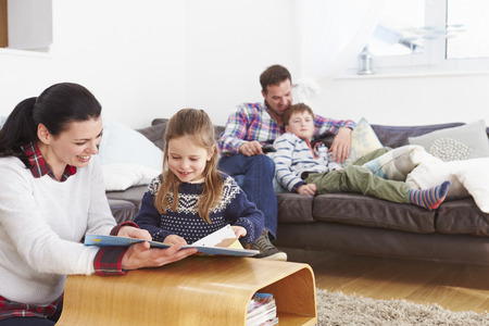 family indoors: Family Relaxing Indoors Together