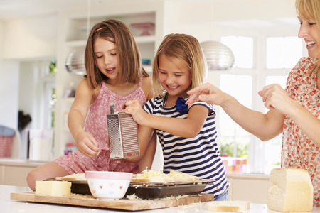 cheese grater: Girls With Mother Making Cheese On Toast