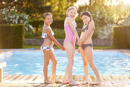 Group Of Girls Playing In Outdoor Swimming Pool photo