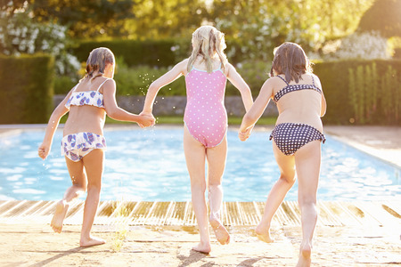 swimsuits: Group Of Girls Jumping Into Outdoor Swimming Pool