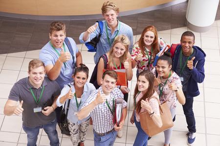 toge: Overhead Portrait Of College Students Standing In Hallway Stock Photo